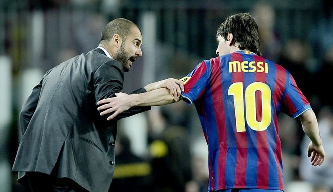 FC Barcelona's Lionel Messi from Argentina, right, chats with his coach Josep Guardiola after he scored against Athletic Bilbao during their Spanish La Liga soccer match at the Camp Nou stadium in Barcelona, Spain, Saturday, April 03, 2010. (AP Photo/David Ramos)