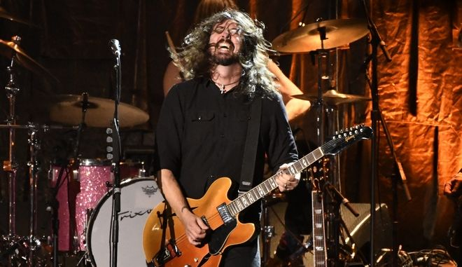 """Dave Grohl, of Foo Fighters, performs """"Honey Bee"""" at the MusiCares Person of the Year tribute honoring Tom Petty at the Los Angeles Convention Center on Friday, Feb. 10, 2017. (Photo by Chris Pizzello/Invision/AP)"""