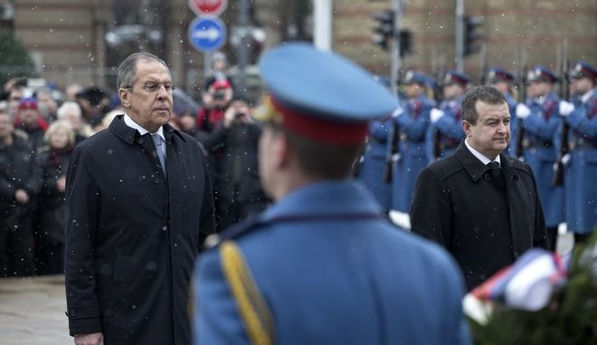 Russian foreign minister Sergey Lavrov, left, and his Serbian counterpart Ivica Dacic, right, pay their respects at the Cemetery of WWII Liberators of Belgrade, in Belgrade, Serbia, Thursday, Feb. 22, 2018. Lavrov is on a two-day official visit to the Serbian capital. (AP Photo/Marko Drobnjakovic)