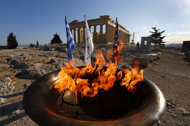 The cauldron with the Olympic Flame is seen atop the Athens Acropolis Wednesday May 16, 2012 during a ceremony.