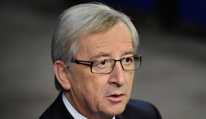 Luxembourg Prime Minister and Eurogroup President Jean-Claude Juncker addresses journalists as he arrives for an informal dinner gathering European Union (EU) heads of State or government on the eve of an European Union summit at the EU headquarters on December 8, 2011 in Brussels.    AFP PHOTO / JOHN THYS (Photo credit should read JOHN THYS/AFP/Getty Images)