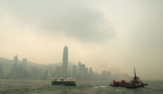 ** FILE ** Pollution spoils the view as one of Hong Kong's historic Star Ferries, left, makes its way across Victoria Harbor in thick brownish haze in this Aug. 19, 2004 file photo. Visibility in Hong Kong deteriorated to its worst-ever level in 2004, the Hong Kong Observatory said Thursday, Jan. 6, 2005, victim of rapid increases in sooty emissions from factories, power plants and cars across southern China. (AP Photo/Anat Givon)