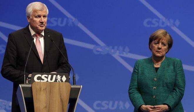 Ο Αρχηγός των Βαυαρών Χριστιανοκοινωνιστών (CSU) Χορστ Ζεεχόφερ και η Άγκελα Μέρκελ