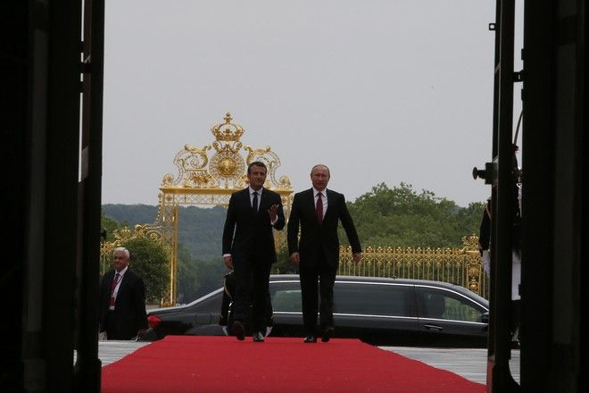 French President Emmanuel Macron and his Russian counterpart President Vladimir Putin arrive at the Palace of Versailles, near Paris, France, Monday, May 29, 2017. Monday's meeting comes in the wake of the Group of Seven's summit over the weekend where relations with Russia were part of the agenda, making Macron the first Western leader to speak to Putin after the talks. (AP Photo/Francois Mori, pool)