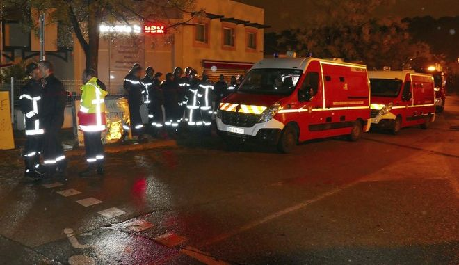 Firefighters and ambulances are seen in the village of Montferrier-sur-Lez, southern France, Friday, Nov. 25, 2016. The French gendarmerie says a masked gunman has burst into a retirement home for monks in southern France and killed an elderly woman with a knife. The press service for the national military police couldn't immediately say whether the incident is linked to a terror act or not. (AP Photo)
