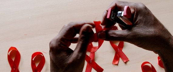 A HIV-positive person from the Support and Care Centre of the Sumanahalli Society prepares 'red ribbons' on the eve of World Aids Day in Bangalore on November 30, 2015.  Globally about 36.9 million people are living with HIV including 2.6 million children, while the global response to HIV has averted 30 million new HIV infections and nearly 8 million deaths since 2000.   AFP PHOTO/ Manjunath KIRAN / AFP / Manjunath Kiran        (Photo credit should read MANJUNATH KIRAN/AFP/Getty Images)