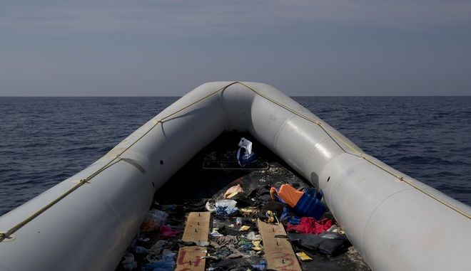 In this April 6, 2017, view of an empty rubber boat after migrants were rescued by members of Proactive Open Arms NGO, in the Mediterranean sea, about 56 miles north of Sabratha, Libya. (AP Photo/Bernat Armangue)