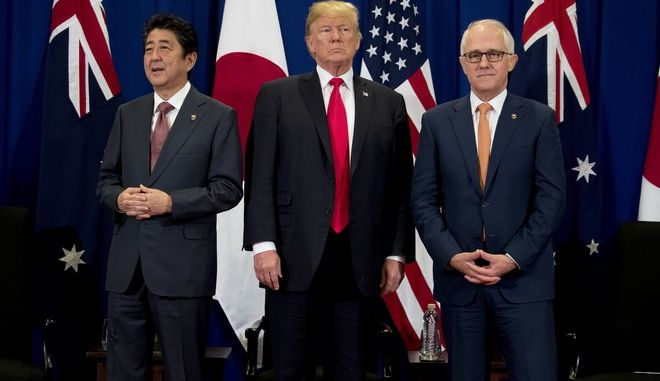 Japanese Prime Minister Shinzo Abe, left, accompanied by President Donald Trump and Australian Prime Minister Malcolm Turnbull, right, speaks during a meeting at the ASEAN Summit at the Sofitel Philippine Plaza, Monday, Nov. 13, 2017, in Manila, Philippines. Trump is on a five country trip through Asia traveling to Japan, South Korea, China, Vietnam and the Philippines. (AP Photo/Andrew Harnik)