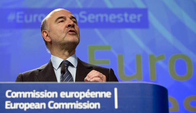 European Commissioner for Economic and Financial Affairs Pierre Moscovici speaks during a media conference at EU headquarters in Brussels on Wednesday, Nov. 16, 2016. The European Union is warning eight countries including Italy, Portugal and Spain that their budget plans for next year might not comply with the rules governing the euro single currency. (AP Photo/Virginia Mayo)