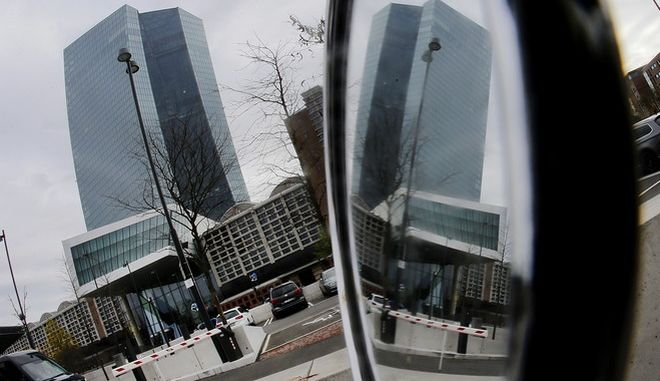 The European Central Bank is reflected in a scooter mirror during a press conference of ECB President Mario Draghi in Frankfurt, Germany, Thursday, Oct. 26, 2017. (AP Photo/Michael Probst)