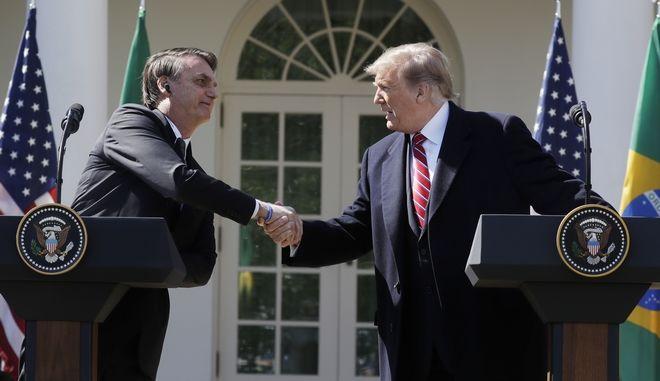 Ο Αμερικανός πρόεδρος Ντόναλντ Τραμπ και ο Βραζιλιάνος ομόλογός του Ζαΐχ Μπολσονάρο σε συνέντευξη Τύπου στον Λευκό Οίκο