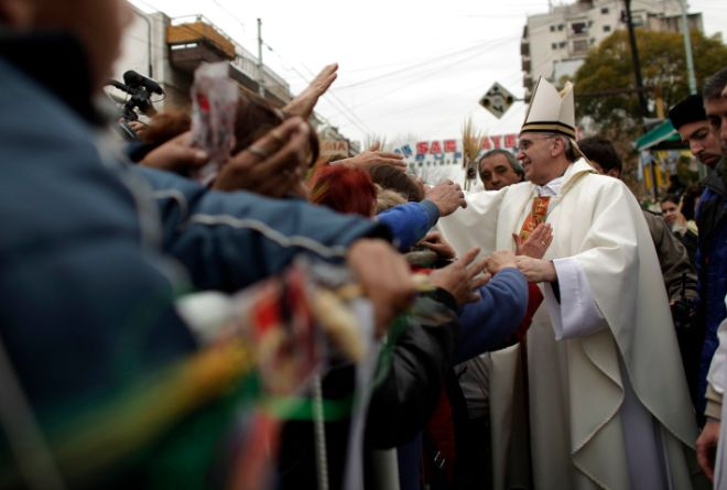 Argentina's Cardinal Jorge Bergoglio, right, gives a mass outside San Cayetano church in Buenos Aires, Friday Aug.7, 2009. The Pope recently called Argentina's sharp rise in poverty