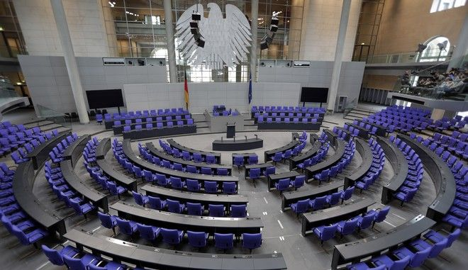 Interior view of the plenar hall of the German Federal Parliament, Bundestag, at the Reichstag building in Berlin, Germany, Tuesday, Sept. 26, 2017. (AP Photo/Michael Sohn)