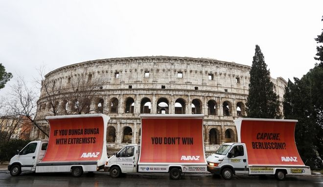 IMAGE DISTRIBUTED FOR AVAAZ - Three billboards addressing Italian former premier Silvio Berlusconi in front of the Colosseum, on the morning after election day on Monday, March 5, 2018, in Rome, Italy. The billboards have been organised by the global civic movement Avaaz as a reaction to the right-wing coalition around Berlusconi and Salvini not reaching a majority in the Italian elections, and read: 'If you Bunga Bunga with extremists, you don't win. Capiche, Berlusconi?'' (Riccardo De Luca/AP Images for Avaaz)