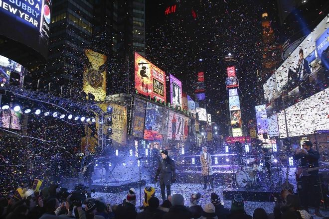 Nick Jonas performs on stage at the New Year's Eve celebration in Times Square on Sunday, Dec. 31, 2017, in New York. (Photo by Brent N. Clarke/Invision/AP)