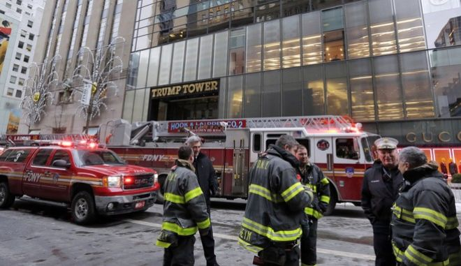 New York City Fire Deptartment vehicles sit on Fifth Avenue in front of Trump Tower, in New York, Monday, Jan. 8, 2018. The department says the fire started around 7 a.m. Monday in the heating and air conditioning system of the building on Fifth Avenue in Manhattan. (AP Photo/Richard Drew)