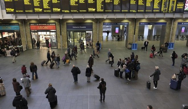 Commuters at the central London terminus overground rail station Kings Cross Station, Tuesday Jan. 2, 2018, as rail passengers face increased fares for travelling on the rail network. Travelers on Tuesday faced average fare hikes of 3.4 percent, prompting complaints from activist groups and London's mayor amid resentment because of the reputation of being unreliable. (Stefan Rousseau/PA via AP)