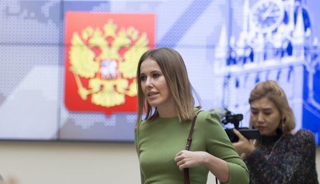 Russian celebrity TV host Ksenia Sobchak, who wants to challenge Russian President Vladimir Putin in the March 18 presidential election, walks after submitting endorsement papers in support of his presidential bid to a member of Russia's Central Election commission in Moscow, Russia, Monday, Dec. 25, 2017. (AP Photo/Ivan Sekretarev)