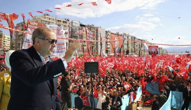 Turkey's President Recep Tayyip Erdogan addresse supporters during a referendum rally in Izmir, Turkey, Sunday, April 9, 2017. Turkey is heading to a contentious April 16 referendum on constitutional reforms to expand Erdogan's powers.(Kayhan Ozer/Presidential Press Service, Pool Photo via AP)