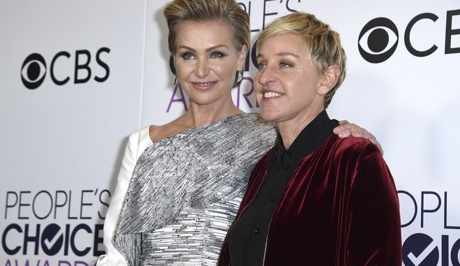 Portia de Rossi, left, and Ellen DeGeneres, winner of the awards for favorite animated movie voice, favorite daytime TV host, and favorite comedic collaboration, pose in the press room at the People's Choice Awards at the Microsoft Theater on Wednesday, Jan. 18, 2017, in Los Angeles. DeGeneres is now the most decorated People's Choice Award winner in the show's history. (Photo by Jordan Strauss/Invision/AP)