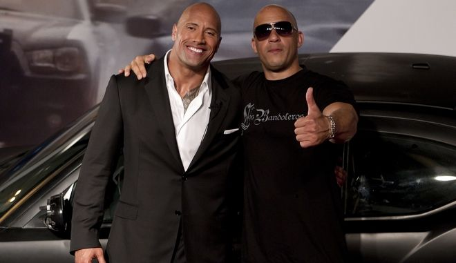 Actors Vin Diesel, right, and Dwayne Johnson pose for photos as they arrive to attend the premiere of the film Fast Five in Rio de Janeiro, Brazil, Friday April 15, 2011. (AP Photo/Felipe Dana)