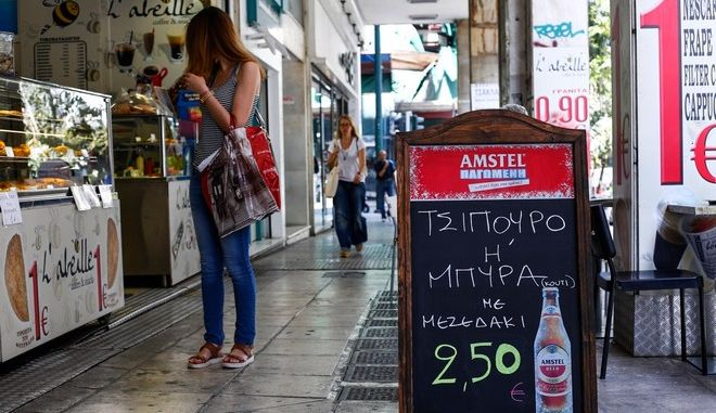 Greek VAT increases from 23% to 24% on all products and services. Snapshots from Athens, on June 1, 2016 /      23%  24%       .    , 1 , 2016