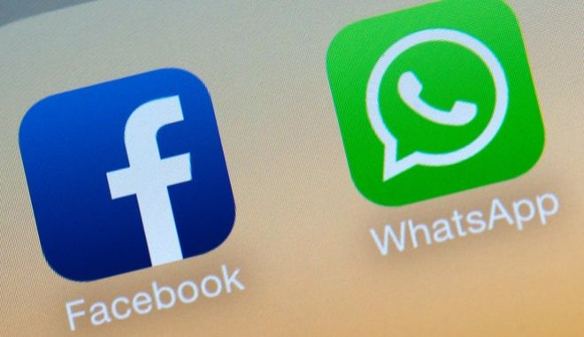 ILLUSTRATION - The logo of the messaging app WhatsApp and the logo of social networking site Facebook on a smartphone in Visselhoevede, Germany, 19 February 2014. Photo: Daniel Reinhardt