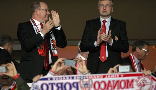 Prince Albert II of Monaco, left, and president of AS Monaco Dmitry Rybolovlev cheer their team before the Champions League quarterfinal second leg soccer match between Monaco and Juventus at Louis II stadium in Monaco, Wednesday, April 22, 2015. (AP Photo/Lionel Cironneau)