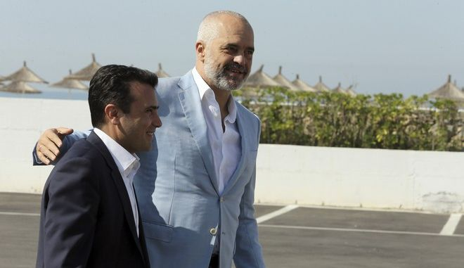 Albanian Prime Minister Edi Rama , right, welcomes his Macedonian counterpart Zoran Zaev during an an informal meeting of Western Balkans countries in the Albanian port city of Durres, 33 kilometers (20 miles) west of the Tirana. Prime ministers from Western Balkans countries have gathered for an informal meeting to discuss deepening regional economic cooperation as part of the process for joining the European Union. (AP Photo/Hektor Pustina)