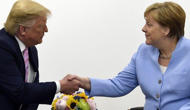 Ο Ντόναλντ Τραμπ και η Άνγκελα Μέρκελ