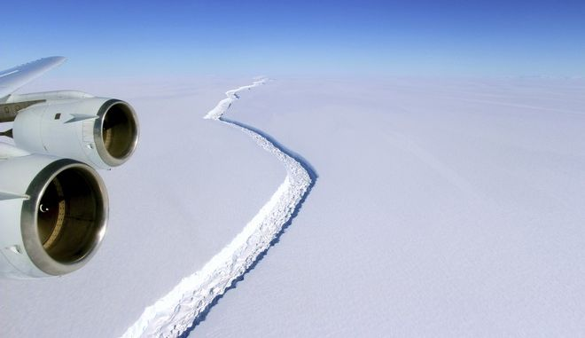 This Nov. 10, 2016 aerial photo released by NASA, shows a rift in the Antarctic Peninsula's Larsen C ice shelf. A vast iceberg with twice the volume of Lake Erie has broken off from a key floating ice shelf in Antarctica, scientists said Wednesday July 12, 2017 . The iceberg broke off from the Larsen C ice shelf, scientists at the University of Swansea in Britain said. The iceberg, which is likely to be named A68, is described as weighing 1 trillion tons (1.12 trillion U.S. tons).(John Sonntag/NASA via AP)