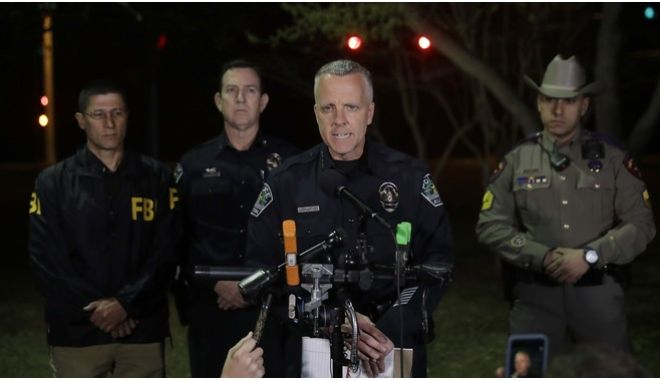 Interim Austin police Chief Brian Manley, center, talks to the media after an explosion, early Monday, March 19, 2018, in Austin, Texas. The area around the explosion site has been blocked off and authorities are interviewing neighbors and searching for possible witnesses. (AP Photo/Eric Gay)