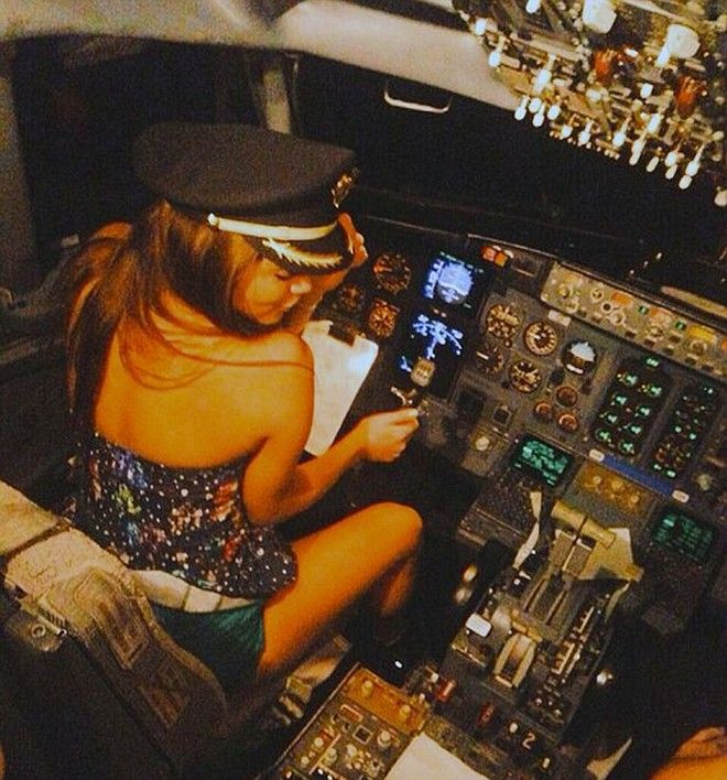 Pic shows: A pilot has been fired after this picture was shared on social networks. It shows how the pilot let famous local singer Esmeralda Ugalde sit down in his seat. The pilot of a plane flying between the Mexican city of Cancun and the capital Mexico City  has been fired after he let a famous local singer sit down in his seat and gave her the command of the aircraft.  He was caught out when the star Esmeralda Ugalde, 23, shared a photo the captain had taken of her with followers on Twitter.  From there it went viral, and after the pilot was identified he was fired by his employers at Magnicharters, an airline that operates domestic holiday flights out of Mexico City International Airport.  Company spokesman Jorge Badia confirmed that the captain who allowed Esmeralda Ugalde, sister of the Latin Grammy Award winner Ana Barbara, and her female friend Samadhi Zendejas, 19, to enter the cockpit had been sacked.  He said: