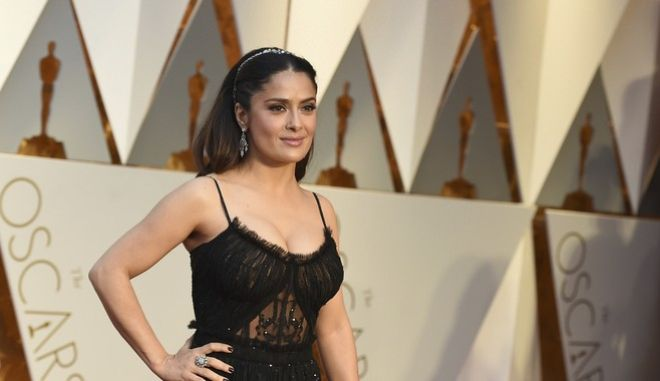 Salma Hayek arrives at the Oscars on Sunday, Feb. 26, 2017, at the Dolby Theatre in Los Angeles. (Photo by Jordan Strauss/Invision/AP)
