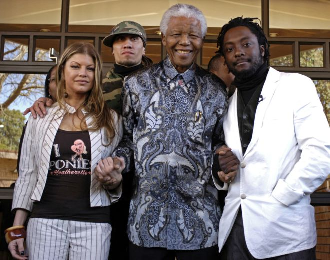 Black Eyed Peas band members, left to right, Fergie, Taboo and William, meet with former President, Nelson Mandela, second from right, in Johannesburg, Monday, May 29, 2006. The band performed at a benefit concert in Johanensburg Sunday. (AP Photo/Russel Roberts)