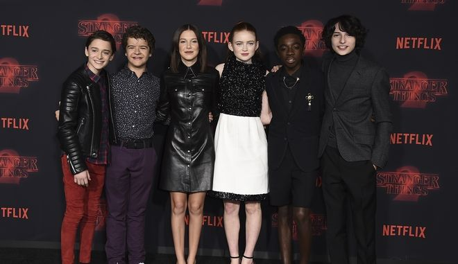 "From left, Noah Schnapp, Gaten Matarazzo, Millie Bobby Brown, Sadie Sink, Caleb McLaughlin and Finn Wolfhard arrive at the Los Angeles premiere of ""Stranger Things"" season two at the Regency Bruin Theatr on Thursday, Oct. 26, 2017 in Los Angeles. (Photo by Jordan Strauss/Invision/AP)"