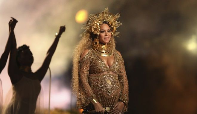 FILE - This Feb. 12, 2017, file photo shows Beyonce performing at the 59th annual Grammy Awards in Los Angeles. Beyonce and Jay Z celebrated the impending birth of their twins with a push party on May 20, 2017. (Photo by Matt Sayles/Invision/AP, File)