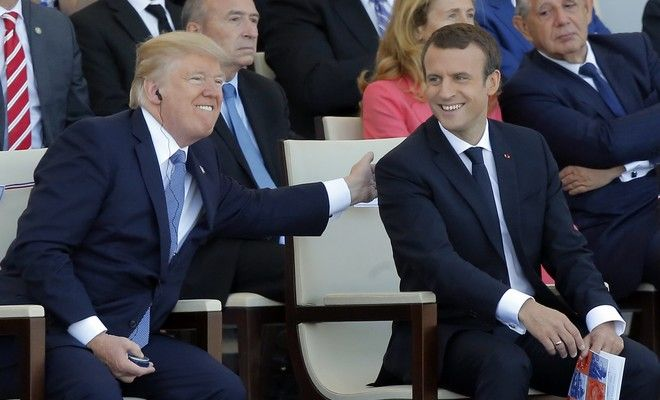 French President Emmanuel Macron, right, and U.S. President Donald Trump attend the traditional Bastille Day military parade on the Champs Elysees, in Paris, Friday, July 14, 2017. (AP Photo/Michel Euler)