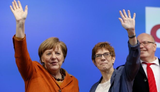 FILE - In this March 23, 2017 file photo German Chancellor Angela Merkel, left, and Governor of German federal state Saarland and CDU top candidate Annegret Kramp-Karrenbauer wave during an election campaign in St.Wendel, Germany. The federal state elections for Saarland will be on Sunday, March 26. (AP Photo/Michael Probst, file)