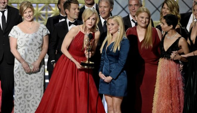 """Nicole Kidman, center left, Reese Witherspoon, center right, and cast and crew accept the award for outstanding limited series for """"Big Little Lies"""" at the 69th Primetime Emmy Awards on Sunday, Sept. 17, 2017, at the Microsoft Theater in Los Angeles. (Photo by Chris Pizzello/Invision/AP)"""