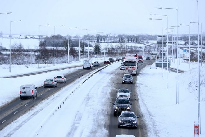 Traffic is reduced to one lane in the snow on the M9 in Co. Kildare, Ireland, Wednesday Feb. 28, 2018. Britain, which is buffered by the Atlantic Ocean and tends to have temperate winters, saw heavy snow in some areas that disrupted road, rail and air travel and forced hundreds of schools to close. (Niall Carson/PA via AP)