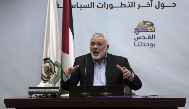 CORRECTS NAME SPELLING TO HANIYEH - Palestinian Hamas top leader Ismail Haniyeh, gives a speech during a press conference in his office in Gaza City, Tuesday, Jan. 23, 2018. Haniyeh says that U.S. Vice President Mike Pences tour in Israel was unwelcome, adding that his speech before the Israeli parliament a day earlier proves the USA has a strategic alliance with the Zionist entity. (AP Photo/ Khalil Hamra)