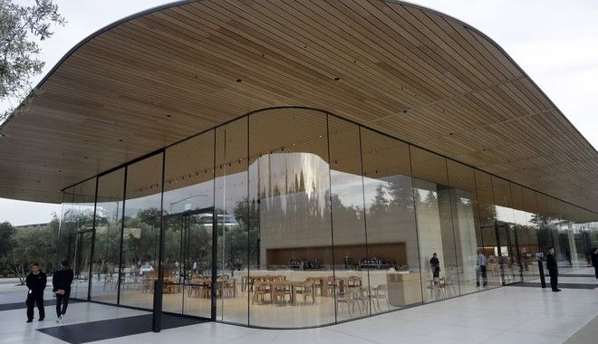 An exterior view of Apple's new visitor center during an announcement of new products Sept. 12, 2017, in Cupertino , Calif. (AP Photo/Marcio Jose Sanchez)