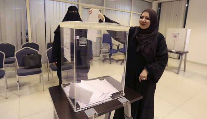 Saudi women vote at a polling center during the country's municipal elections in Riyadh, Saudi Arabia, Saturday, Dec. 12, 2015. Saudi women are heading to polling stations across the kingdom on Saturday, both as voters and candidates for the first time in this landmark election. (AP Photo/Aya Batrawy)