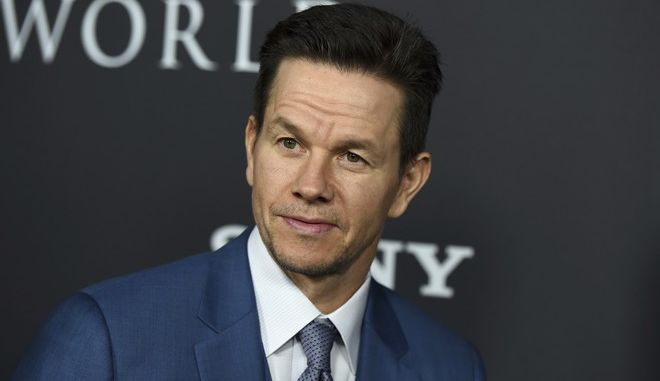 "Mark Wahlberg arrives at the world premiere of ""All the Money in the World"" at the Samuel Goldwyn Theater on Monday, Dec. 18, 2017, in Beverly Hills, Calif. (Photo by Jordan Strauss/Invision/AP)"