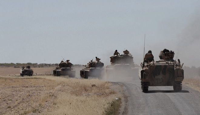 In this photo taken on Friday, Sept. 2, 2016, Turkish tanks head to the Syrian border, in Karkamis, Turkey. Turkish troops and allied Syrian rebels expelled the Islamic State group from the last strip of territory it controlled along the Syrian-Turkish border on Sunday, effectively sealing the extremists' self-styled caliphate off from the outside world, Turkey's state-run news agency reported.(Ismail Coskun, IHA via AP)