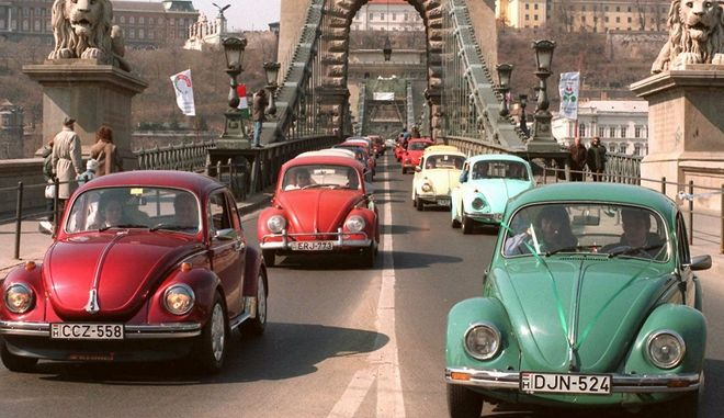"Some of more than 600 Volkswagen Beetles cross Budapest's Lanchid (Chain bridge) Sunday March 31, 1996, on the day of the Hungarian ""Beetles fan club"". The members of this club drive through Budapest's streets every year, usually on April 1st, but this year they changed the date to carry out their appearance on a Sunday. (AP Photo/Tibor Rozsahegy)"