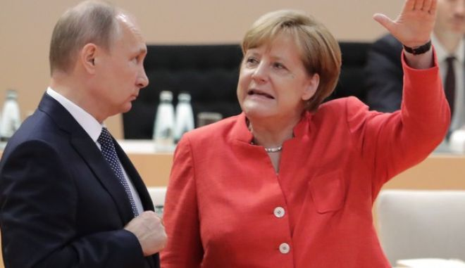 Russian President Vladimir Putin, left, talks with German Chancellor Angela Merkel prior to the first working session on the first day of the G-20 summit in Hamburg, northern Germany, Friday, July 7, 2017. The leaders of the group of 20 meet July 7 and 8. (AP Photo/Markus Schreiber)