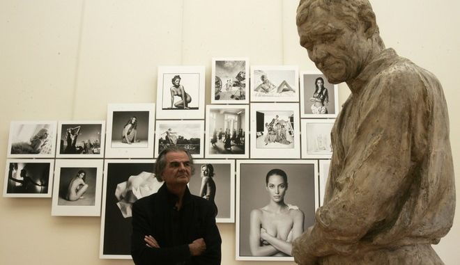 """** EDS NOTE: NUDITY ** French photographer Patrick Demarchelier is seen at the Petit Palais in Paris, Friday, Sept. 26, 2008. He has photographed Princess Diana in diamonds, Madonna in lingerie and model Gisele Bundchen in the buff. But celebrated photographer Patrick Demarchelier says none of the hundreds of pop culture icons he's immortalized in 30 years behind the lens compares to his dog, a long-haired dachshund whom he calls """"the perfect model."""" Puffy stars in an exhibition of more than 400 of Demarchelier's renowned portraits at Paris' Petit Palais. (AP Photo/Michel Euler)"""