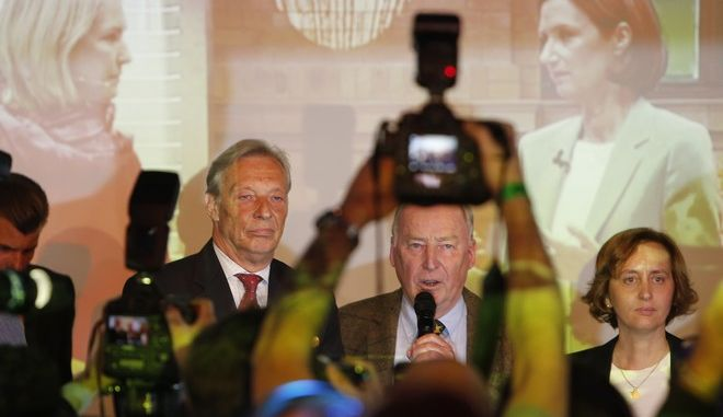 Alexander Gauland, co-top candidate of the nationalist German AfD (Alternative for Germany) party, center, holding microphone, goes on stage during the election party in Berlin, Germany, Sunday, Sept. 24, 2017, after the polling stations for the German parliament elections had been closed. (AP Photo/Michael Probst)